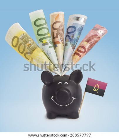 Ten,twenty,fifty,one hundred and a 200 Euro banknote in a smiling piggybank of Angola.(series) - stock photo
