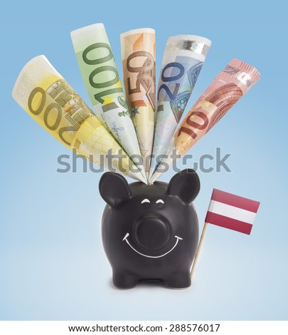 Ten,twenty,fifty,one hundred and a 200 Euro banknote in a smiling piggybank of Austria.(series) - stock photo