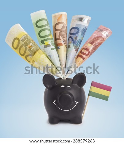 Ten,twenty,fifty,one hundred and a 200 Euro banknote in a smiling piggybank of Bolivia.(series) - stock photo