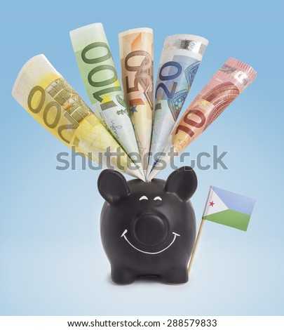 Ten,twenty,fifty,one hundred and a 200 Euro banknote in a smiling piggybank of Djibouti.(series) - stock photo