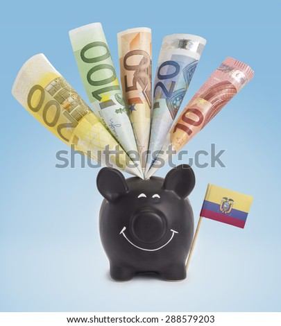 Ten,twenty,fifty,one hundred and a 200 Euro banknote in a smiling piggybank of Ecuador.(series) - stock photo