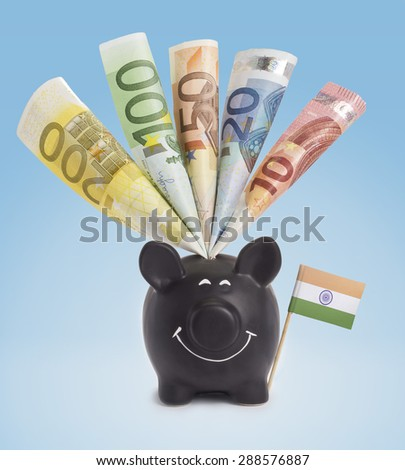 Ten,twenty,fifty,one hundred and a 200 Euro banknote in a smiling piggybank of India.(series) - stock photo
