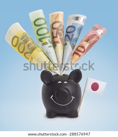 Ten,twenty,fifty,one hundred and a 200 Euro banknote in a smiling piggybank of Japan.(series) - stock photo