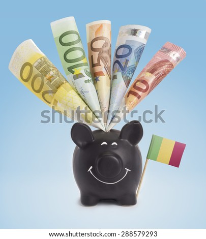 Ten,twenty,fifty,one hundred and a 200 Euro banknote in a smiling piggybank of Mali.(series) - stock photo