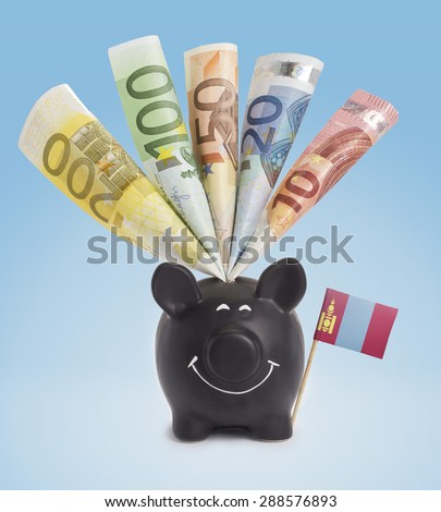 Ten,twenty,fifty,one hundred and a 200 Euro banknote in a smiling piggybank of Mongolia.(series) - stock photo