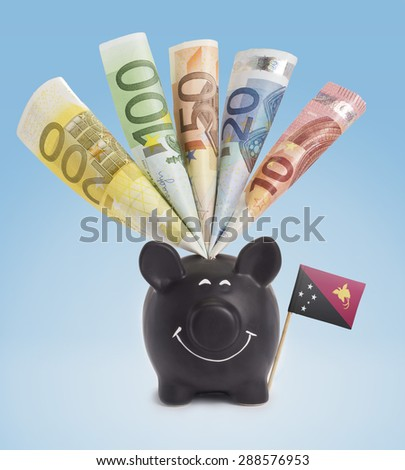 Ten,twenty,fifty,one hundred and a 200 Euro banknote in a smiling piggybank of Papua New Guinea.(series) - stock photo