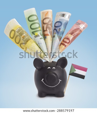Ten,twenty,fifty,one hundred and a 200 Euro banknote in a smiling piggybank of Sudan.(series) - stock photo