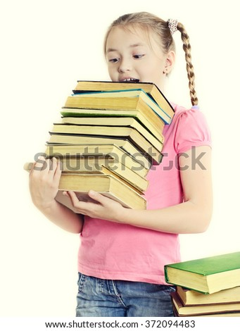 Ten-year girl with a bewildered expression holds a lot of books. - stock photo