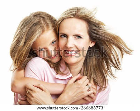 Ten year old caucasian girl with her mother. - stock photo