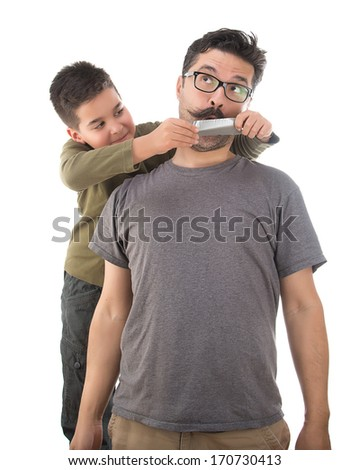 Ten year old child shuts his father's mouth isolated on white background - stock photo