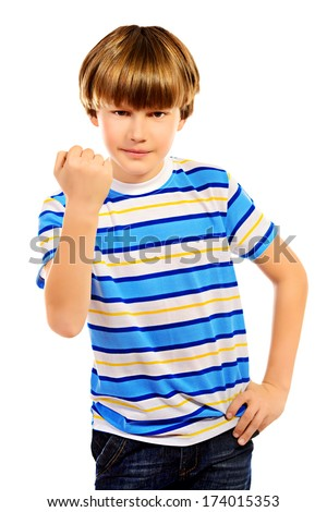 Ten years boy shakes his fist at someone. Isolated over white. - stock photo