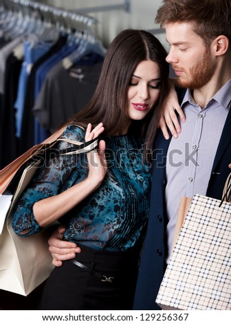 Tender amazing couple is in the shop - stock photo