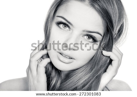 Tender and sensual young beautiful woman, slightly toned black and white portrait - stock photo