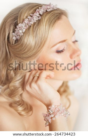 Tender beauty portrait of bride with accessories wreath in hair - stock photo