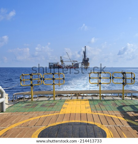 Tender Drilling Oil Rig (Barge Oil Rig) on The Production Platform View from Crew Boat - stock photo
