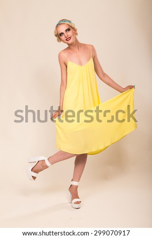 Tender girl in the yellow dress. Portrait beautiful girl in retro style. Hair and make-up in vintage style. Beauty, fashion photo - stock photo
