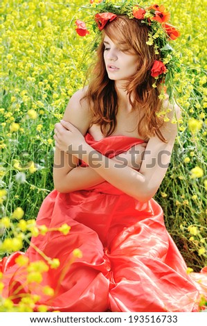 tender lady with wreath in field - stock photo