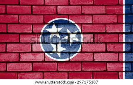 Tennessee state flag of America on brick wall - stock photo
