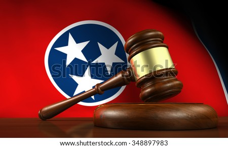 Tennessee state law, legal system and justice concept with a 3d render of a gavel on a wooden desktop and the Tennessean flag on background. - stock photo