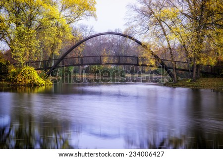 Tenney Park bridge on a fall morning - stock photo