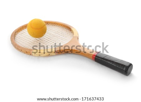 Tennis ball and racket from 1970s. - stock photo