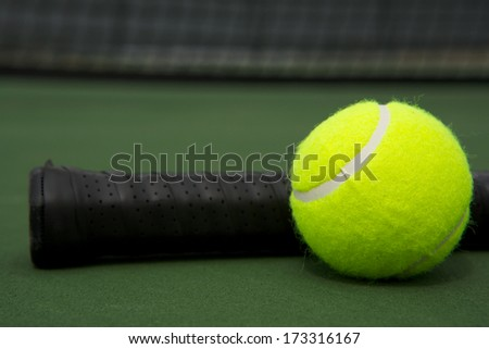 Tennis Ball and Racket Handle with room for copy - stock photo