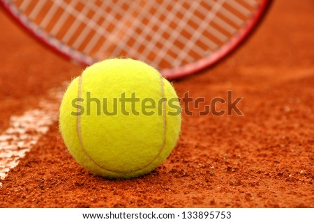 Tennis ball and racket on the court - stock photo