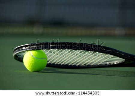 Tennis Ball and Racket with room for copy - stock photo