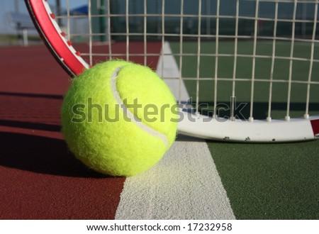 Tennis ball and racquet - stock photo