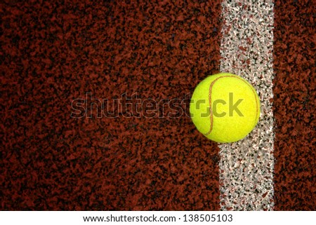 Tennis ball hitting the line for a point, top view - stock photo
