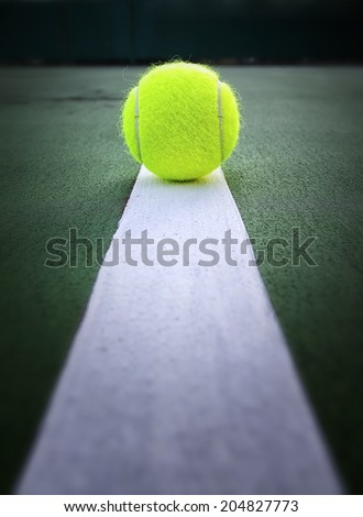 Tennis ball in tennis court - stock photo