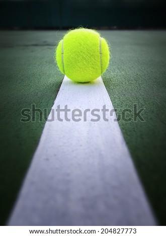 Tennis ball in tennis court - stock photo