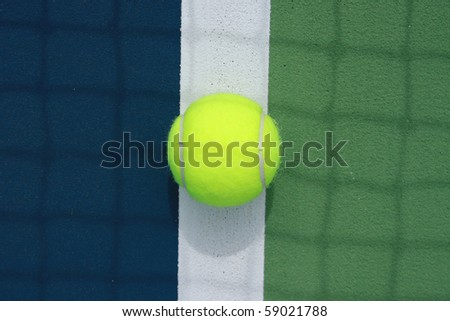 tennis ball in the middle of the boundary line - stock photo