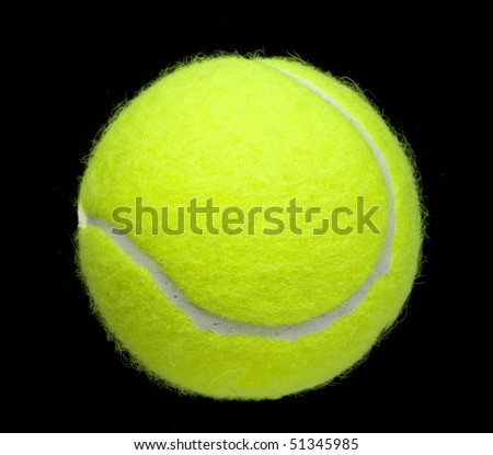 Tennis ball isolated on black - stock photo