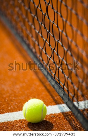 Tennis ball on a court, closeup view. - stock photo