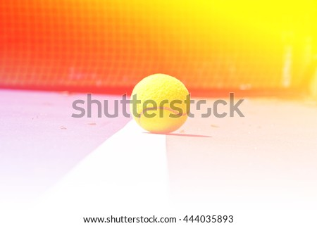Tennis ball on court with color filters - stock photo