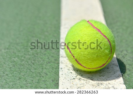 Tennis Ball on the Court Close up - stock photo