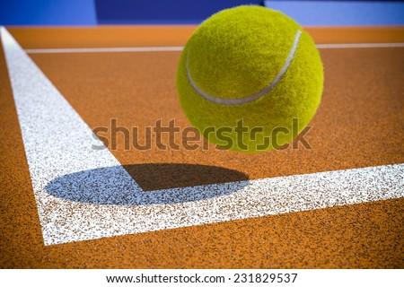 Tennis ball to corner red ground field line - stock photo