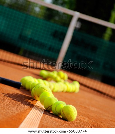 tennis ball, vintage rackets and trophy - stock photo