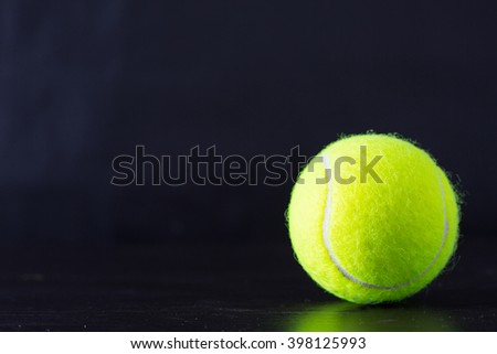 tennis ball with black background. - stock photo