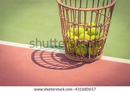 Tennis Ball with old basket tennis court - stock photo