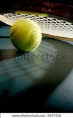 Tennis ball with racket & shadows - stock photo