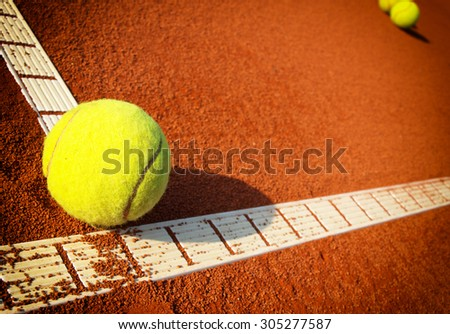 Tennis balls on a tennis clay court - stock photo