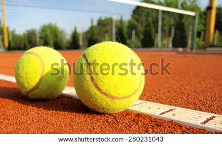 tennis balls on a tennis court - stock photo