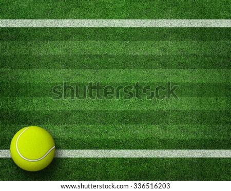 tennis balls on tennis grass court - stock photo