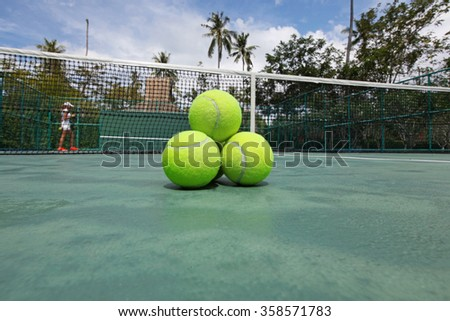 Tennis balls on the court close-up - stock photo