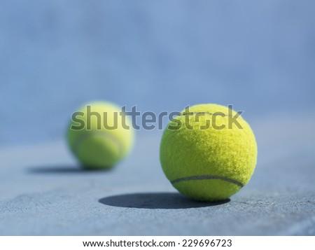 Tennis Balls on the floor - stock photo