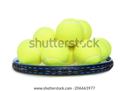 tennis balls piled on racket isolated white background - stock photo