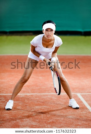 Tennis competition. Female player at the clay tennis court - stock photo