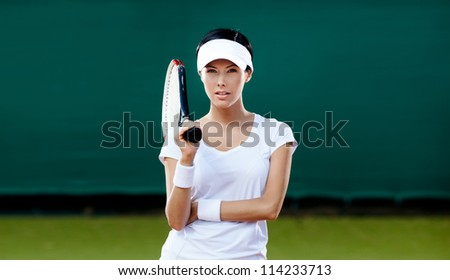 Tennis competition. Female player at the tennis court - stock photo